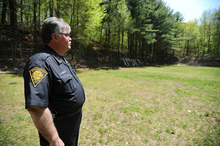 Bridgeport Police Officer Pedro Garcia looks downrange at the Stratford Police Shooting Range in Roosevelt Forest in Stratford, Conn. on Thursday, May 12, 2016. Photo: Brian A. Pounds / Hearst Connecticut Media / Connecticut Post
