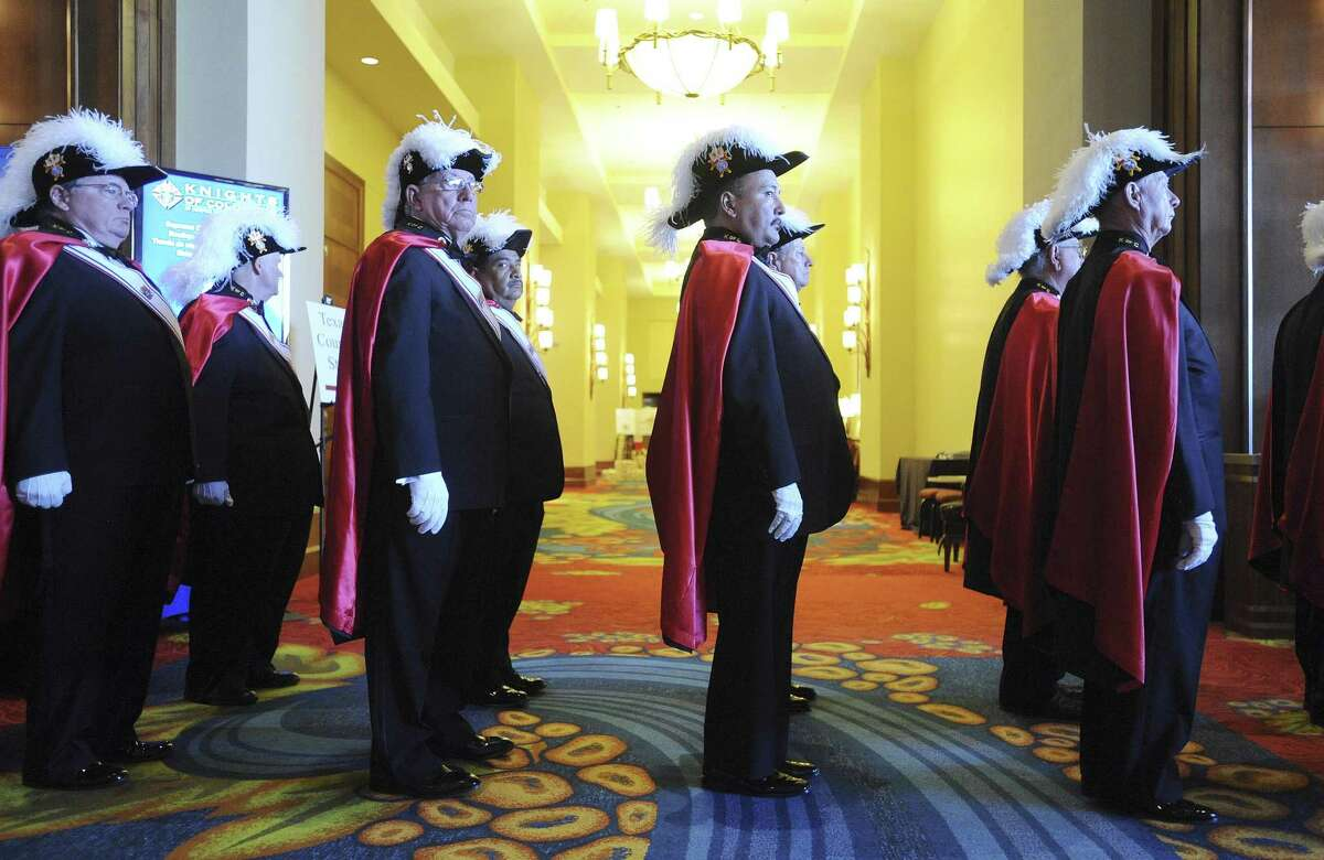 Members of the Knights of Columbus prepare to enter the convention center at the JW Marriott for the opening Mass of the Knights of Columbus 131st International Convention on Tuesday, Aug. 6, 2013.