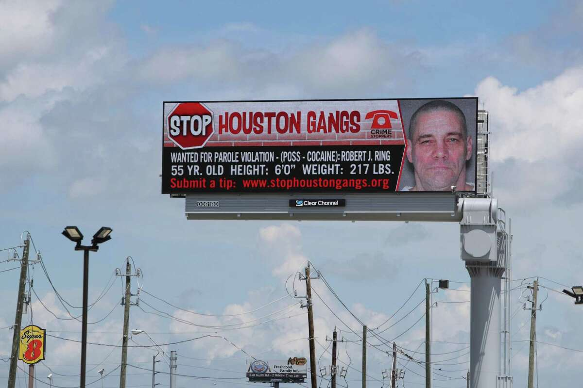 A large digital billboard showing a wanted poster for an Aryan Circle member. Harris County Sheriff's Office is reminding residents to report possible signs of organized criminal activity in their neighborhoods. One resource to help residents identify and report possible gang activity is the website StopHoustonGangs.org.