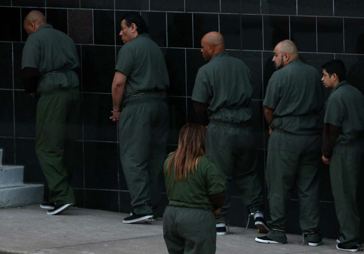Law enforcement authorities take defendants into the federal courthouse in Houston on Nov. 17, 2017. A new study says Hispanic immigrants face harsher federal sentences than whites in regions of the country with newer or no significant Hispanic immigrant populations. Texas did not show a disparity, according to the study published in the journal of the Academy of Criminal Justice Sciences.
