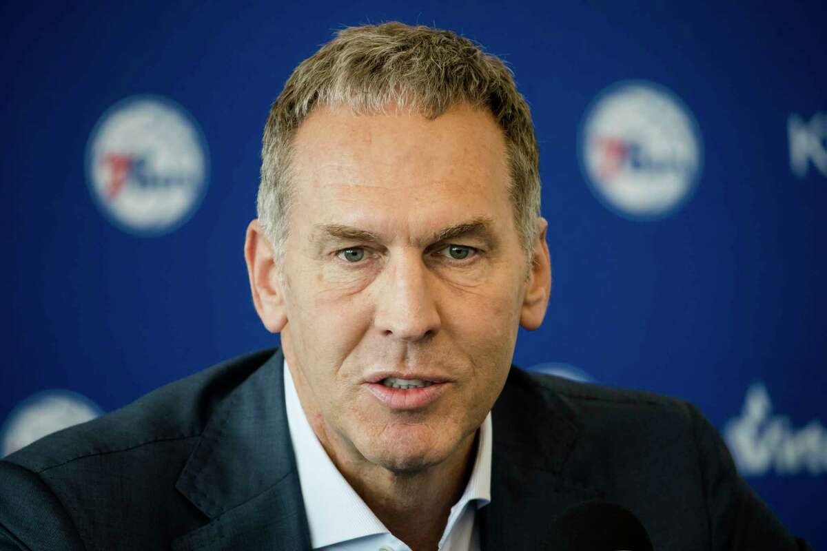 FILE - In this May 11, 2018, file photo, Philadelphia 76ers general manager Bryan Colangelo speaks during a news conference at the NBA basketball team's practice facility in Camden, N.J. Colangelo is denying a report connecting the executive to Twitter accounts that criticized Sixers players Joel Embiid and Markelle Fultz, among other NBA figures. The accounts also took aim at former Sixers GM Sam Hinkie, Toronto Raptors executive Masai Ujiri and former Sixers players Jahlil Okafor and Nerlens Noel, according to a report by The Ringer. (AP Photo/Matt Rourke, File)