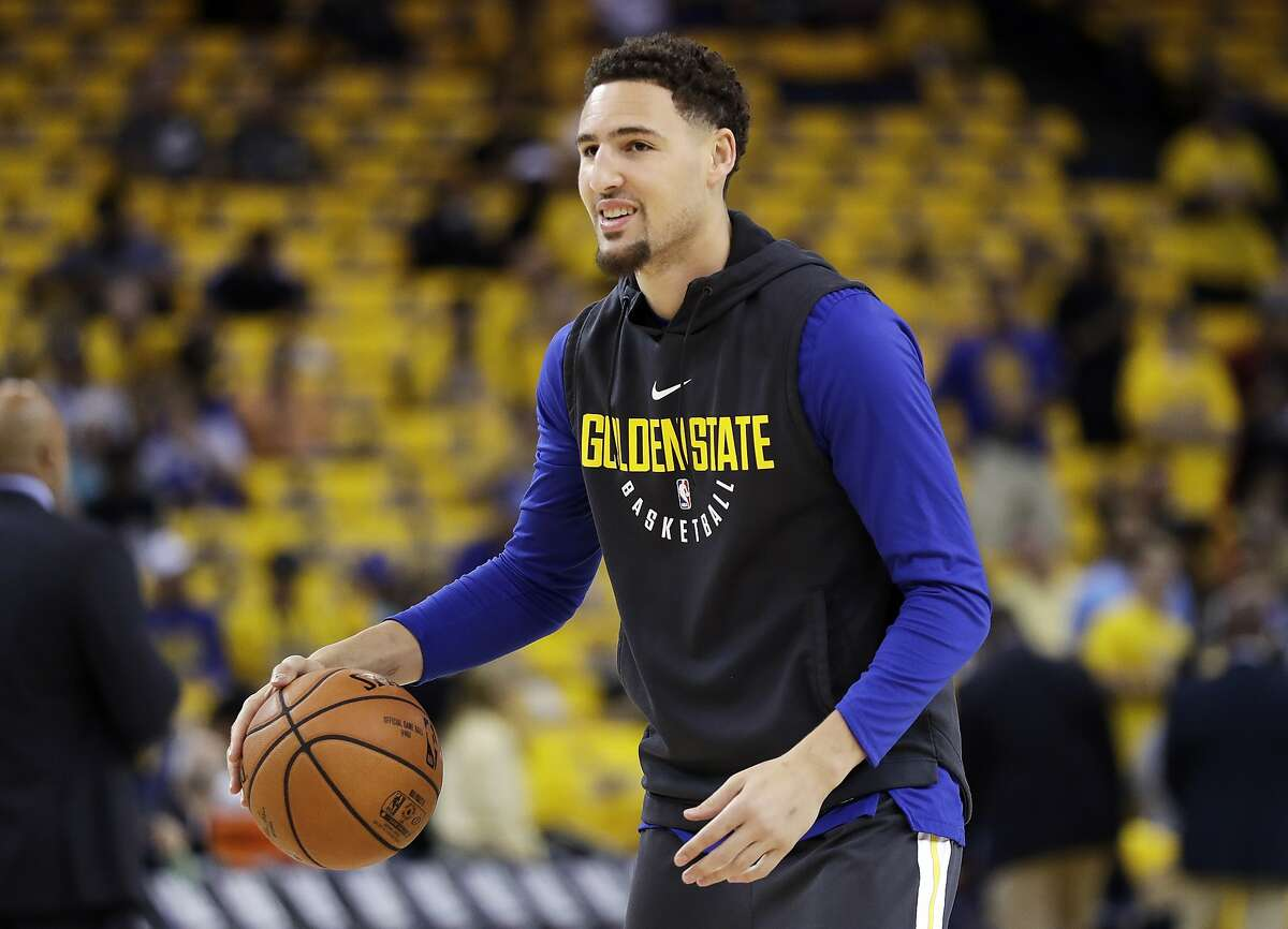 Golden State Warriors guard Klay Thompson warms up before Game 2 of basketball's NBA Finals between the Warriors and the Cleveland Cavaliers in Oakland, Calif., Sunday, June 3, 2018. (AP Photo/Marcio Jose Sanchez)