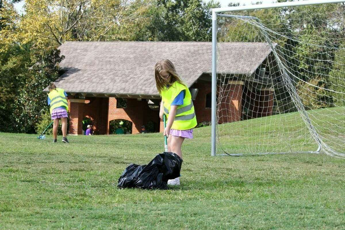 Twin sisters Nicole Devitt and Ariel Devitt helped clean up litter during The Woodlands Township's summer cleanup campaign,