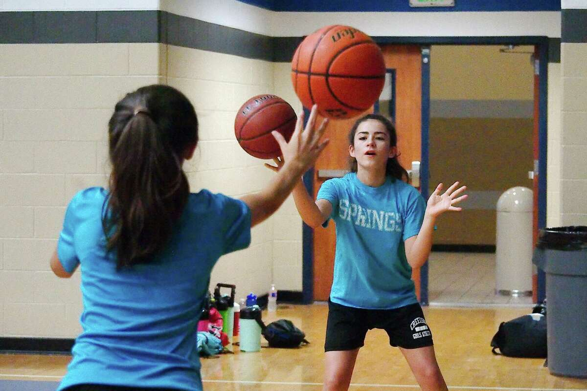 Carley Acosta and Natalie Rivera participate in a passing drill at Clear Springs summer basketball camp Wednesday, June 6.