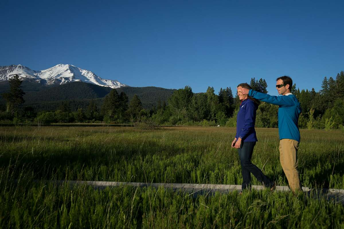 Jenn and Chris Carr walk at Sisson Meadow Park in Mount Shasta, Calif. on Friday, June 1, 2018. Jenn and Chris Carr lead mountain expeditions in Shasta Cascade for adults and teenagers that last between two and five days.