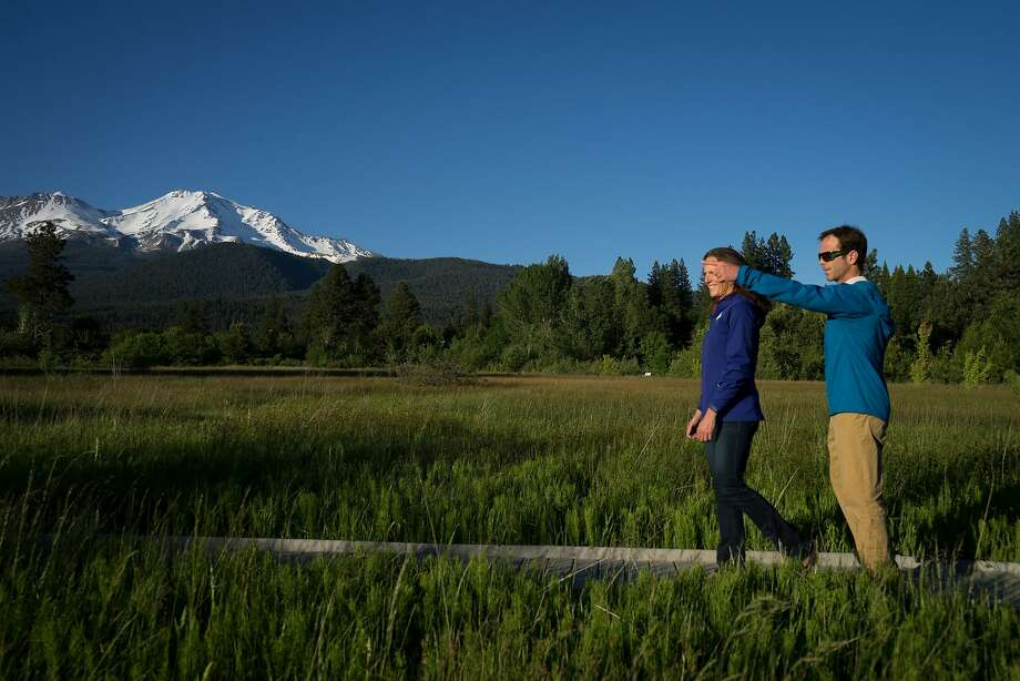 Jenn and Chris Carr walk at Sisson Meadow Park in Mount Shasta. Photo: Sarahbeth Maney / Special To The Chronicle