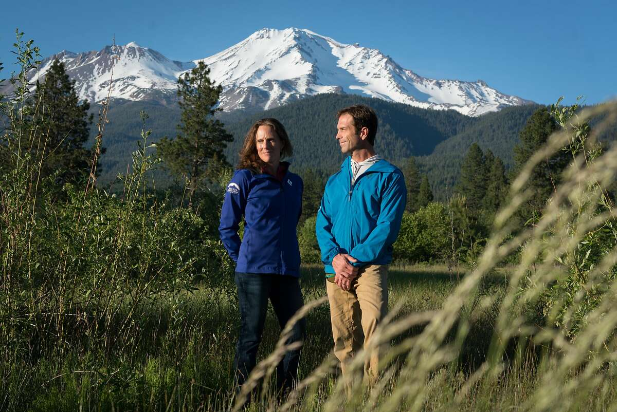 Jenn and Chris Carr stand in front of Mount Shasta at Sisson Meadow Park in Mount Shasta, Calif. on Friday, June 1, 2018. Jenn and Chris Carr lead mountain expeditions in Shasta Cascade for adults and teenagers that last between two and five days.