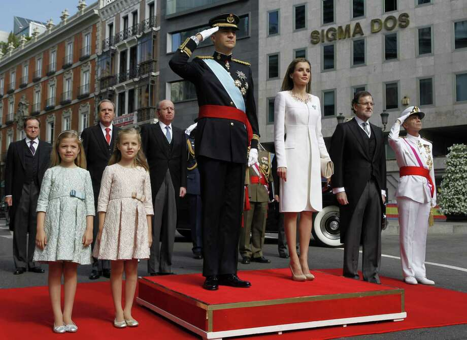 (FILES) In this file photo taken on June 19, 2014 Spanish Princess Sofia, Spanish Crown Princess of Asturias Leonor, Spain's King Felipe VI and Spain's Queen Letizia, Spanish Prime Minister Mariano Rajoy and Head of armed forces Admiral Fernando Garcia Sanchez pose on arrival at the Congress of Deputies, Spain's lower House in Madrid for a swearing in ceremony of Spain's new King before both houses of parliament.  Spain's parliament ousted on June 1, 2018 Prime Minister Mariano Rajoy in a no-confidence vote sparked by fury over his party's corruption woes, with his Socialist arch-rival Pedro Sanchez automatically taking over. / AFP PHOTO / POOL / SERGIO BARRENECHEASERGIO BARRENECHEA/AFP/Getty Images Photo: SERGIO BARRENECHEA, Contributor / AFP/Getty Images / AFP or licensors