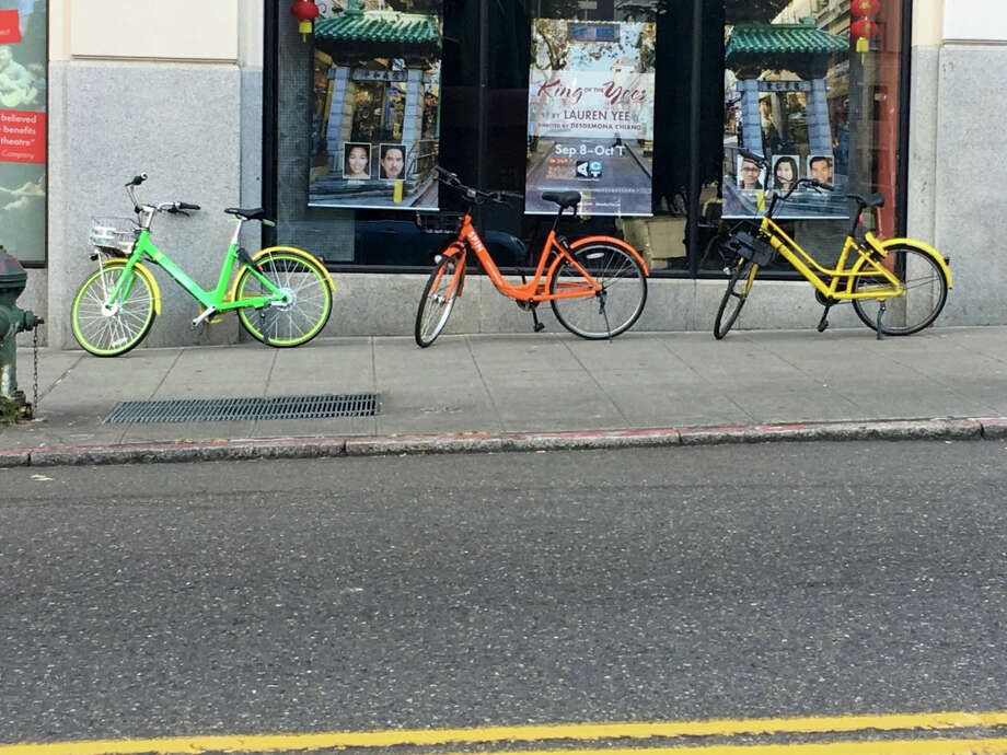 Dockless shared bikes, LimeBike, Spin, and Ofo, in Seattle. Photo: John Cook/Geekwire