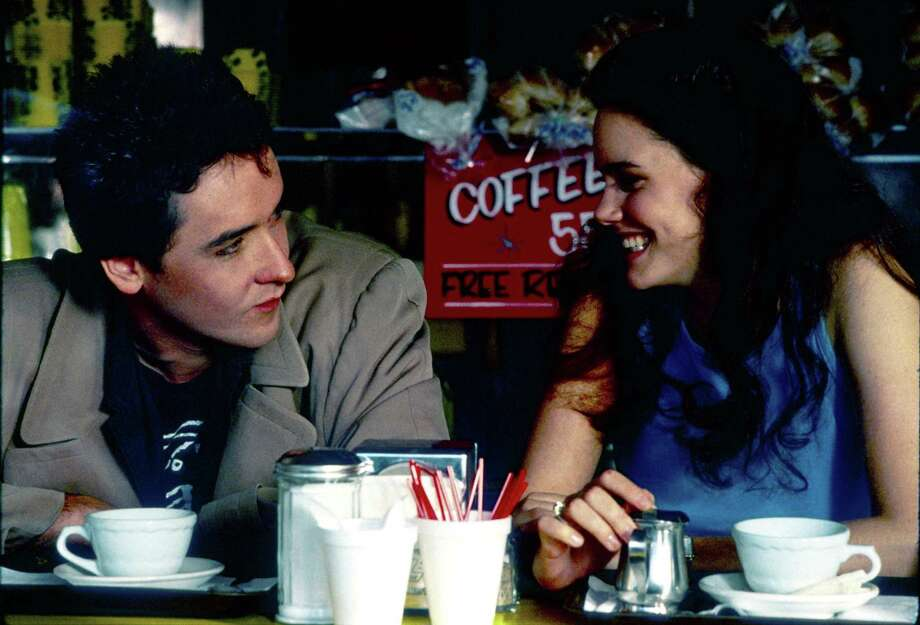 """John Cusack and Ione Skye play a couple in the much-adored movie """"Say Anything."""" Photo: Gemma Lamana Wills /Twentieth Century Fox / handout slide"""