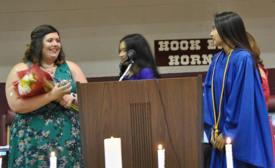 Hart Junior High teacher Julianne Hathcock received the NHS Teacher of the Year award from Hart High School Valedictorian Candyce Neudorf and Salutatorian Alexcia Calderon. The presentation came during the annual HHS Academic Banquet on May 29. Photo: Neoma Williams/Herald Correspondent
