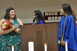 Hart Junior High teacher Julianne Hathcock received the NHS Teacher of the Year award from Hart High School Valedictorian Candyce Neudorf and Salutatorian Alexcia Calderon. The presentation came during the annual HHS Academic Banquet on May 29.
