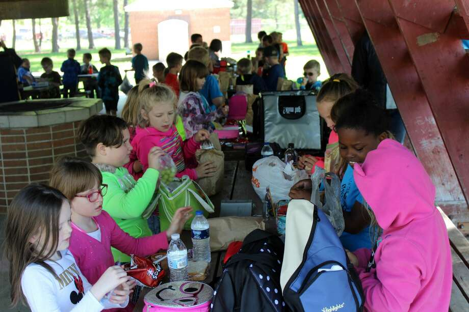 First grade students at Bad Axe and North Huron schools met up Wednesday, at Bad Axe City Park, for lunch and some play time. At the event, each student met their pen pal from the other school, which they had been writing to all year long. Photo: Seth Stapleton/Huron Daily Tribune