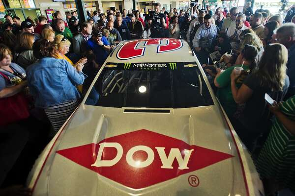 People check out a new Dow-designed racecar during an event featuring two U.S. Olympic medal winners and Daytona 500 champion Austin Dillon on Thursday, June 7, 2018 at Dow Diamond. For more photos from the event, go to www.ourmidland.com. (Katy Kildee/kkildee@mdn.net)
