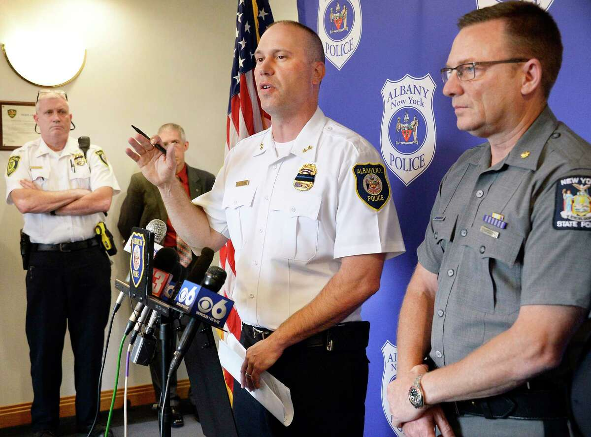 Acting Chief of Police Robert Sears, center, and NYSP Troop G Commander Major Robert Patnaude, right, release details and the identities of the victims of the Erie Boulevard, I-90 deaths during a news conference at police headquaters Thursday June 7, 2018 in Albany, NY. (John Carl D'Annibale/Times Union)