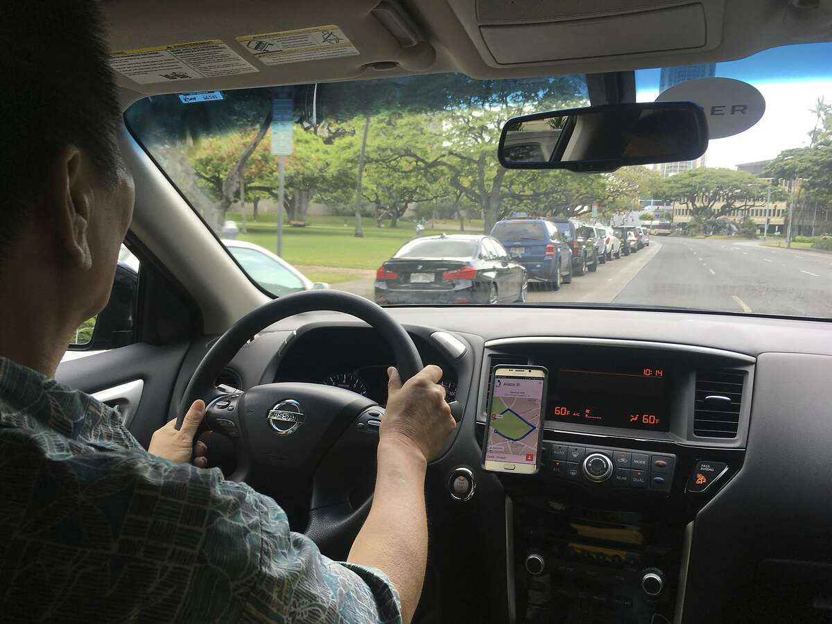 Uber driver Joshua Oh drives in Honolulu on Wednesday, June 6, 2018. Honolulu's city council is scheduled to vote on a bill that won't allow ride-hailing services to impose so-called