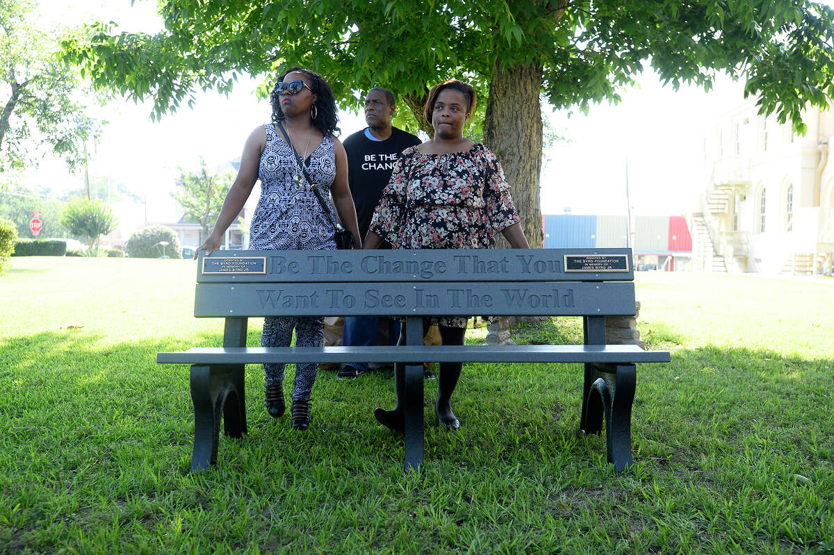 Jamie Byrd-Grant, daughter, Renee Mullins, daughter, and Thurman Byrd, brother, unveil a bench in memory of James Byrd Jr. on the lawn of the Jasper County Courthouse. Photo taken Thursday 6/7/18 Ryan Pelham/The Enterprise