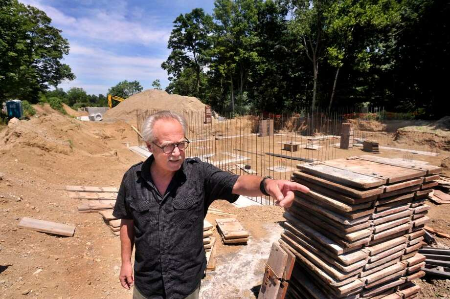 Michael-John Cavallaro, vice chairman of the conservation commission in New Milford, talks about the Indian field on Fort Hill, on Sunday, July 4, 2010. The site is  being developed for affordable housing. Photo: Michael Duffy / The News-Times