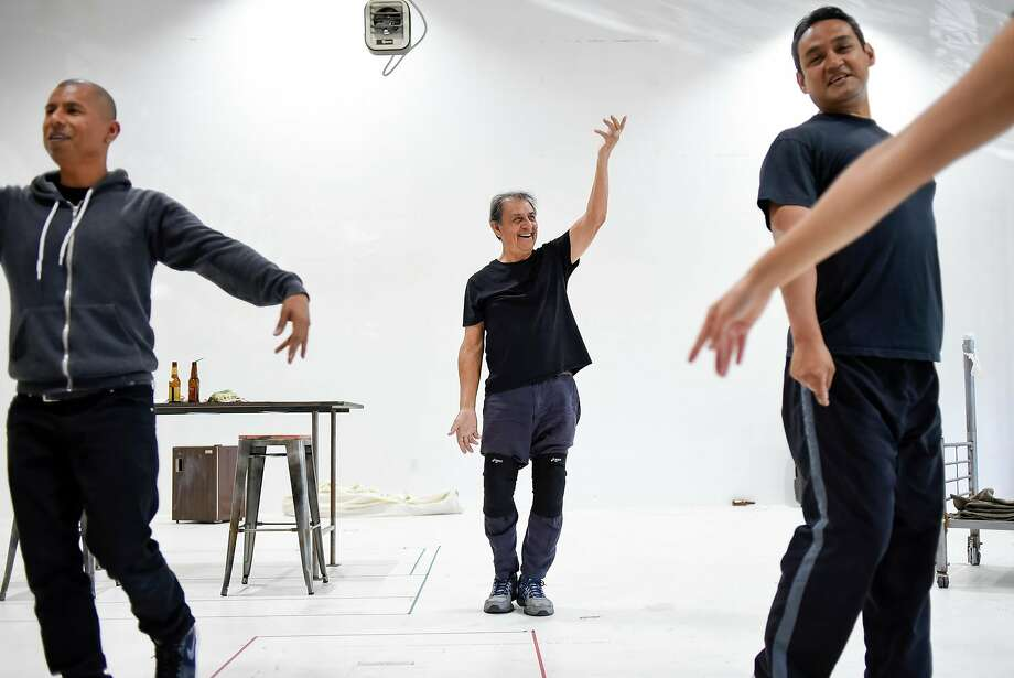 """Emilio Delgado (center) dances with Carlos Aguirre (left) and Sol Castillo during a rehearsal for """"Quixote Nuevo."""" Photo: Michael Short / Special To The Chronicle"""