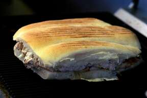 A freshly-grilled torta sandwich is ready for serving at La Torta Gorda restaurant in San Francisco, Calif. on Tuesday, April 24, 2007. PAUL CHINN/The Chronicle Ran on: 05-03-2007 La Torta Gorda on 24th Street, where a $7 sandwich will feed two, now has a dining room and table service.