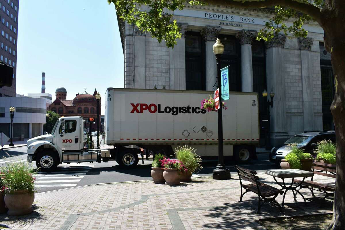 An XPO Logistics truck in downtown Bridgeport, Conn., in August 2017. XPO drivers are independent contractors who bid for jobs, with independent contractors representing about 11 percent of the U.S. economy as of May 2017 according to a Bureau of Labor Statistics study published Thursday, June 7, 2018.
