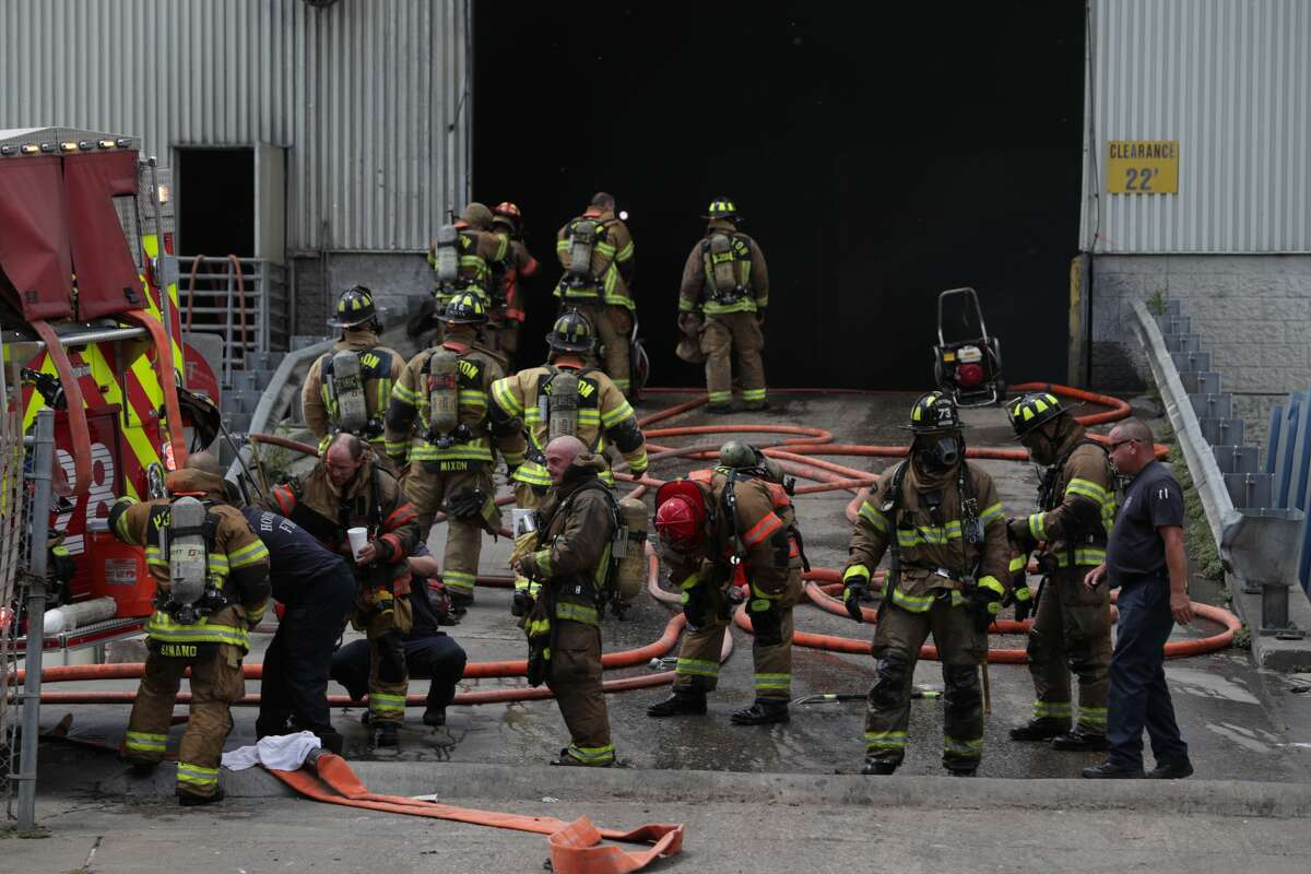 Firefighters respond to a fire at a recycling facility near the intersection of Renwick Drive and the Southwest Freeway, Thursday, June 7, 2018 in Houston. ( Jon Shapley / Houston Chronicle )