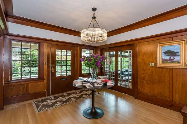 Original woodwork and leaded glass highlight the foyer.