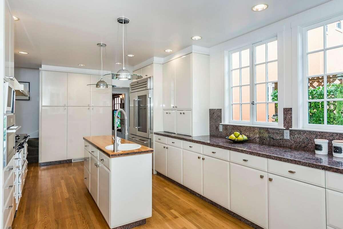 A classic, cast-iron AGA multi-oven range anchors the kitchen.