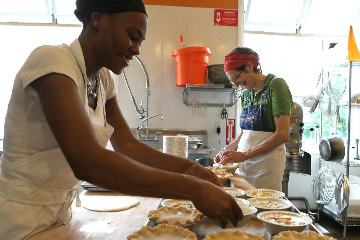 Food prep Raytrina Johnson (left) and Karen Heisler, the co-owner of Mission Pie, make chicken pot pies at the store, Friday, March 13, 2015, in San Francisco, Calif.