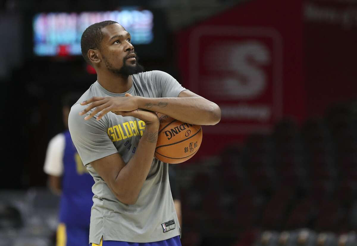 Golden State Warriors forward Kevin Durant (35) warms up as the basketball team's practiced during the NBA Finals, Wednesday, June 7, 2018, in Cleveland. The Warriors lead the series 3-0 with Game 4 on Thursday. (AP Photo/Carlos Osorio)