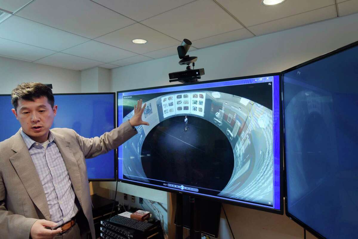 RPI professor, Hui Su, director of CISL, shows a video on the 360 degree virtual environment is seen in a lab at the school on Thursday, June 7, 2018, in Troy, N.Y. (Paul Buckowski/Times Union)