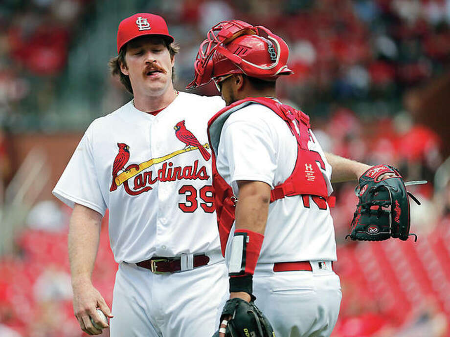 Cardinals starting pitcher Miles Mikolas (39) talks with catcher Francisco Pena during the seventh inning of Thursday's game against the Miami Marlins in St. Louis. Photo:       Jeff Roberson | AP Photo