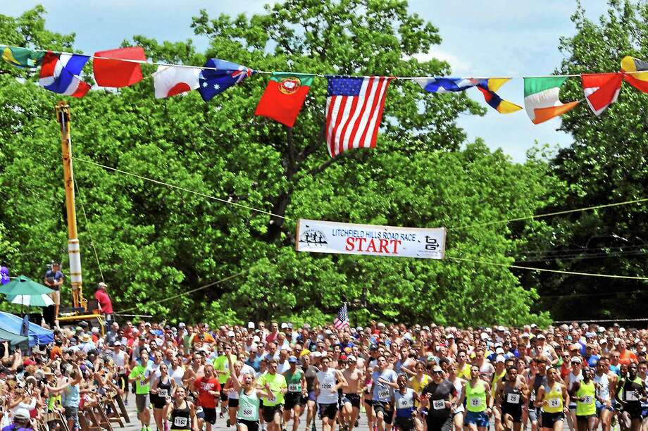 The Litchfield Hills Road Race returns on Sunday, June 10 for the 42nd year. Above, runners take off from the starting line in the 2016 event. Photo: File Photo