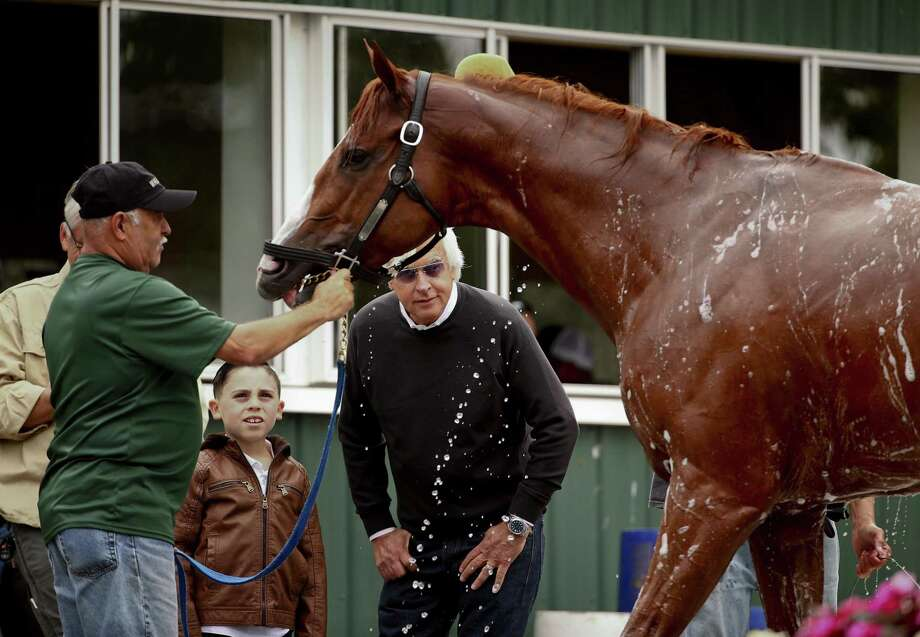 Trainer Bob Baffert, right, watches as Triple Crown hopeful Justify is bathed after a workout at Belmont Park on Thursday. Photo: Peter Morgan / Associated Press / Copyright 2018 The Associated Press. All rights reserved.