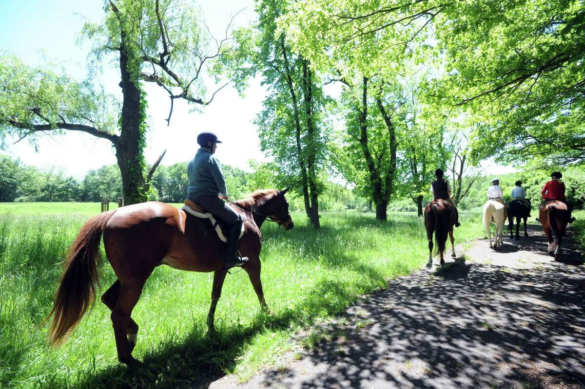 Horse riders that are members of the Greenwich Riding and Trails Association, ride at Nichols Preserve in Greenwich, Conn., Thursday, May 29, 2014. The horse trail riding system in Greenwich is more than 100 years old. The backcountry view riders enjoy has changed greatly in the past few decades.