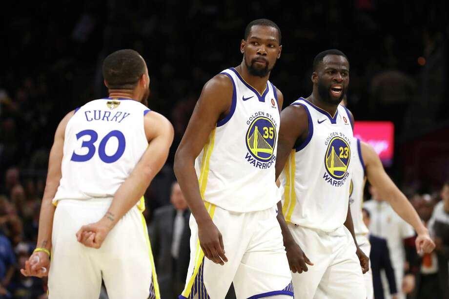 Stephen Curry and Draymond Green celebrate with Kevin Durant after a big 3-pointer in the fourth quarter against the Cavaliers in Game 3 of the NBA Finals. Photo: Gregory Shamus, Staff / Getty Images / 2018 Getty Images