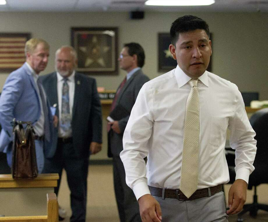 Christopher Delacruz of Magnolia leaves the courtroom after he was found not guilty of murder during a trial in Judge Phil Grants 9th state District court at the Lee G. Alworth Building on Thursday, June 7, 2018, in Conroe. The trail stemmed from the May 2017 shooting of 56-year-old Jose Augusto Lozada outside of his residence in Magnolia. Photo: Jason Fochtman, Staff Photographer / Houston Chronicle / © 2018 Houston Chronicle