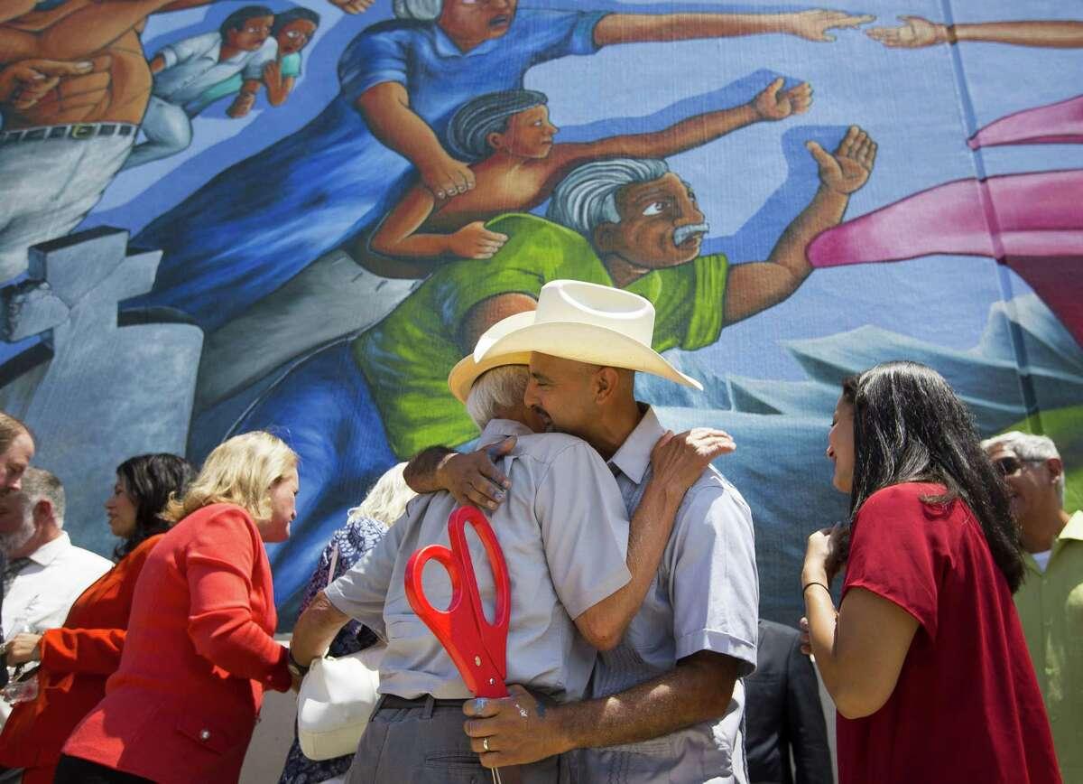 Painter Gonzo 247 embraces Leo Tanguma, the original artist behind the mural