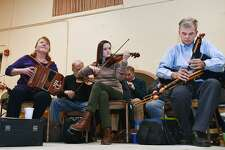 Button accordionist Loretta Egan Murphy, violinist Lindsey Ceitin and master uilleann piper Jerry O'Sullivan play during a session of Irish traditional music for the P.V. O'Donnell branch of the Comhaltas Ceoltóirí Éireann earlier this year. Another session is planned on June 21 at St. Gabriel's Parish Hall in Milford.