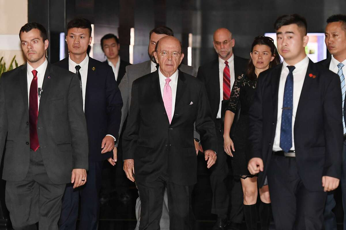 (FILES) In this file photo taken on June 2, 2018 US Commerce Secretary Wilbur Ross (C) leaves a hotel in Beijing. US officials reached a deal on June 7, 2018 to ease sanctions which threatened to cripple Chinese smartphone maker ZTE, Commerce Secretary Wilbur Ross said. Ross told CNBC television the deal includes a $1 billion fine levied on the Chinese firm and a requirement that it change its board of directors. / AFP PHOTO / Greg BakerGREG BAKER/AFP/Getty Images