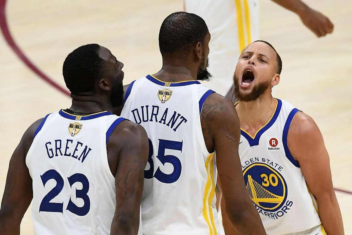 CLEVELAND, OH - JUNE 06: Stephen Curry #30 and Draymond Green #23 of the Golden State Warriors celebrate with Kevin Durant #35 against the Cleveland Cavaliers in the second half during Game Three of the 2018 NBA Finals at Quicken Loans Arena on June 6, 2018 in Cleveland, Ohio. NOTE TO USER: User expressly acknowledges and agrees that, by downloading and or using this photograph, User is consenting to the terms and conditions of the Getty Images License Agreement. (Photo by Jason Miller/Getty Images) *** BESTPIX ***