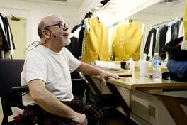 """Lance Hughes gets ready backstage for his role in the ensemble for the Beaumont Community Players production of Mel Brooks' """"Young Frankenstein."""" The community theater, along with many like it, struggles to find male actors. Photo taken Friday 5/18/18 Ryan Pelham/The Enterprise"""