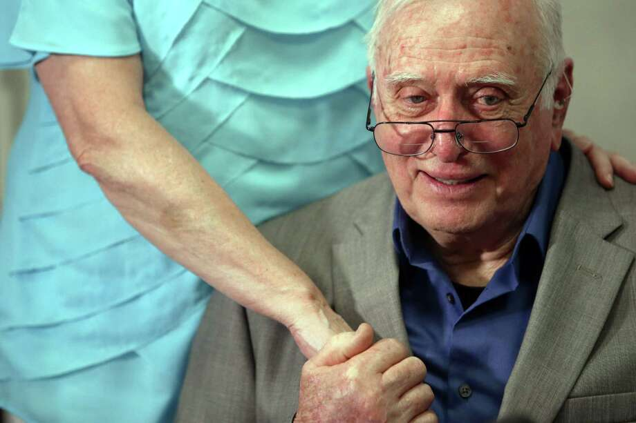 "Rudolf ""Rudy"" Wetzel, 81, holds the hand of his lady friend Lee Dorigan, as he speaks to media during press conference announcing his lawsuit against Amtrak after he was injured in the December train derailment near Dupont. Photo: GENNA MARTIN, GENNA MARTIN, SEATTLEPI.COM / SEATTLEPI.COM"