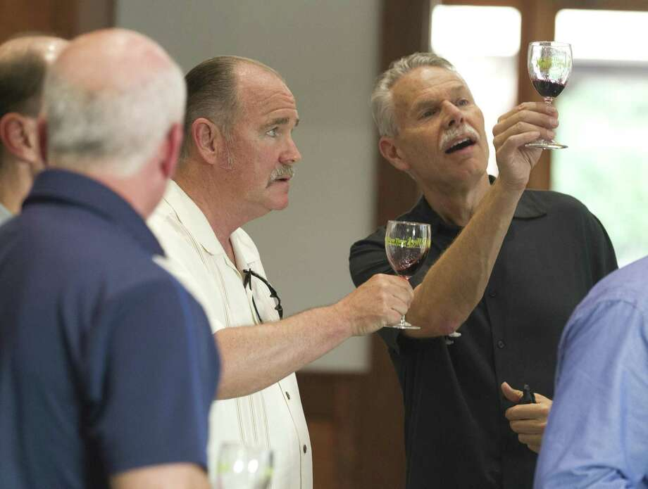 "Bill Berlian, right, talks wine with James Nay during ""It's A Guy Thing,"" which was a part of the annual Wine & Food Week, at The Woodlands Country Club on Tuesday, June 5, 2018, in The Woodlands. This year's ""It's a Guy Thing"" event is set for Tuesday, June 4. Photo: Jason Fochtman, Staff Photographer / Houston Chronicle / © 2018 Houston Chronicle"