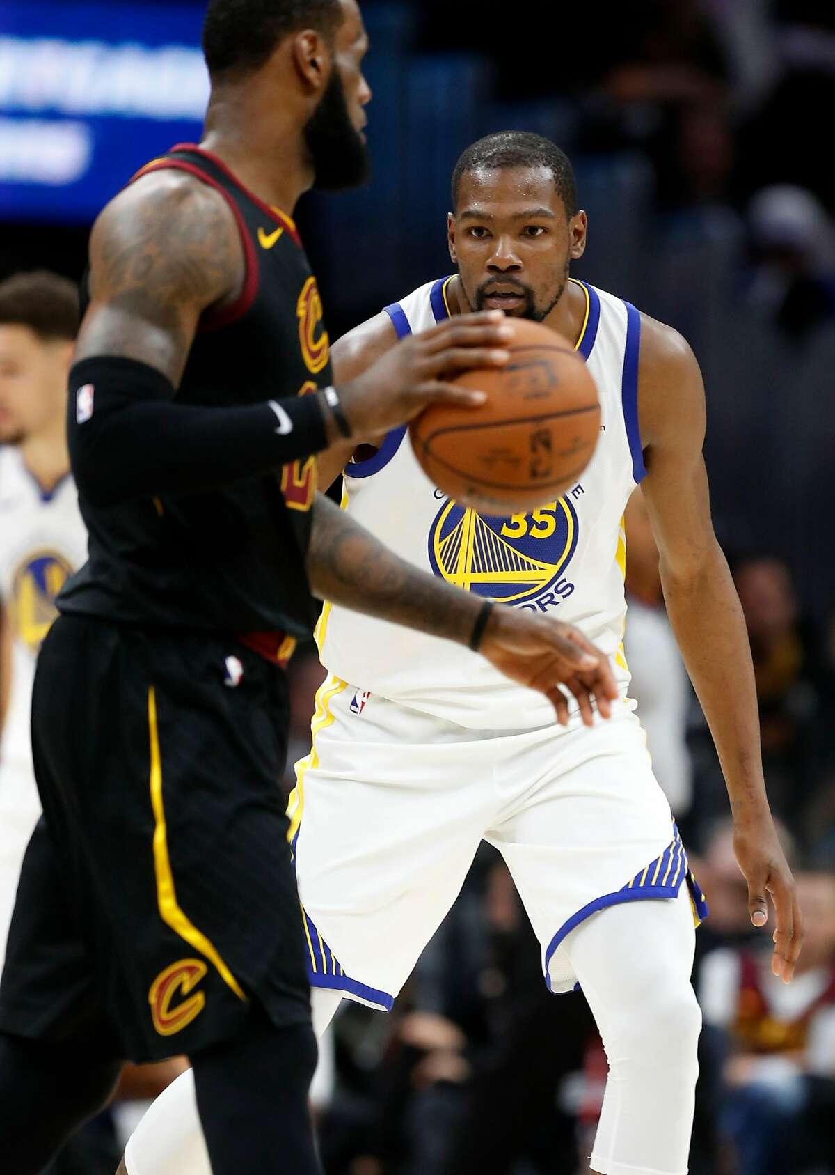 Golden State Warriors' Kevin Durant against Cleveland Cavaliers' LeBron James during Warriors' 110-102 win in Game 3 of the NBA Finals at Quicken Loans Arena in Cleveland, OH on Wednesday, June 6, 2018.