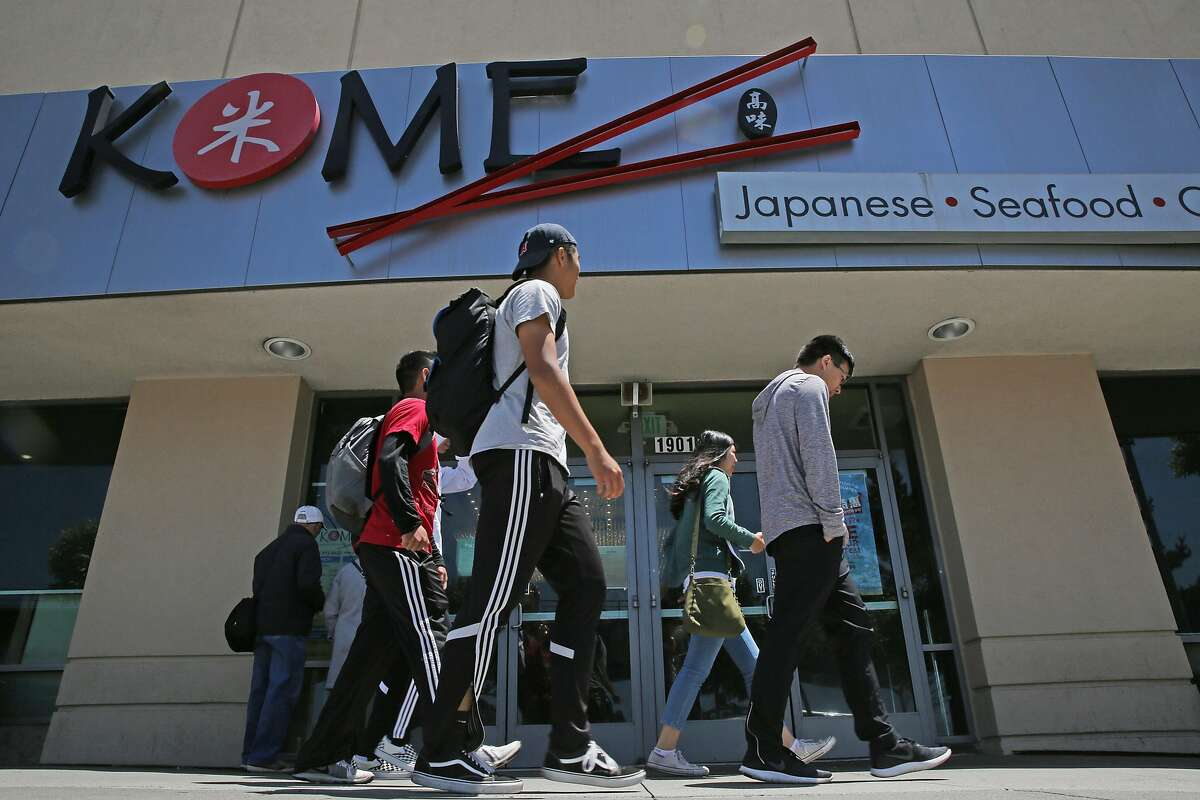 People walk past Kome Buffet, Thursday, June 7, 2018, in Daly City, Calif.