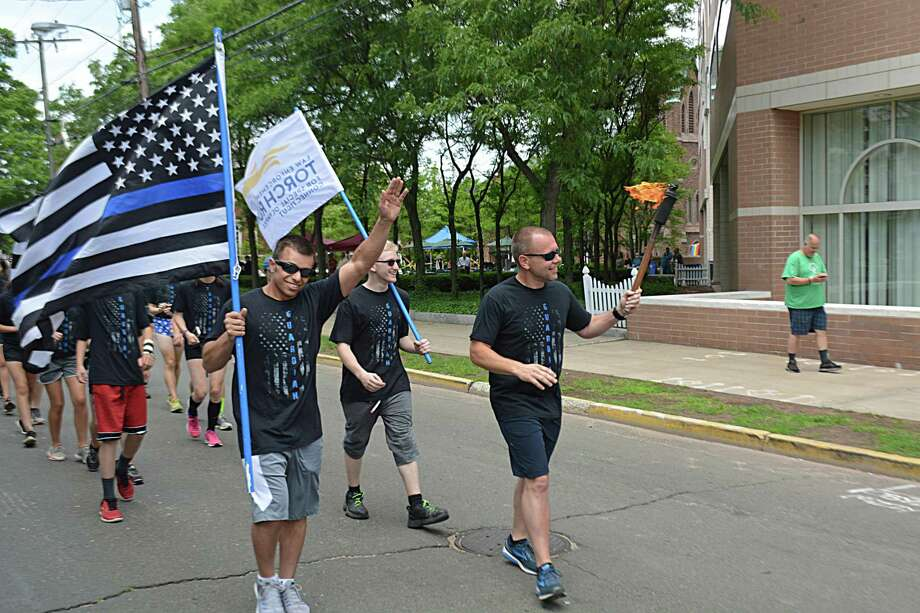 More officers and civilians than ever took part in leg three of the three-day annual Law Enforcement Torch Run for Special Olympics Connecticut, which began Thursday in North Branford. At 1 p.m., the stopped to enjoy lunch outdoors at Middlesex Mutual on Broad Street in Middletown. Photo: Cassandra Day / Hearst Connecticut Media