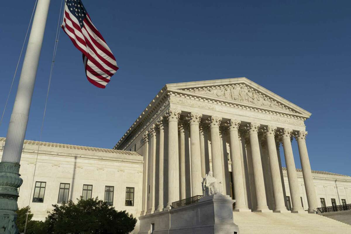 The U.S. Supreme Court is seen in Washington on April 20, 2018. The Supreme Court is setting aside a Colorado court ruling against a baker who wouldnt make a wedding cake for a same-sex couple. But the court is not deciding the big issue in the case, whether a business can refuse to serve gay and lesbian people. (AP Photo/J. Scott Applewhite)