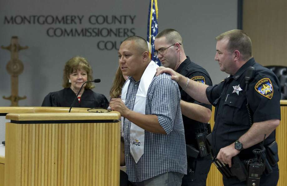 Javier Cervantes, a graduate of the Veterans Treatment Court, becomes emotional as he speaks about his life after the program as he prepares to graduate from Houston Community College during the court's third annual graduation ceremony at the Alan B. Sadler Commissioners Court Building, Wednesday, May 9, 2018, in Conroe. The specialty court focuses on giving veterans with felony or misdemeanor charges a chance to join an outpatient treatment program. Photo: Jason Fochtman, Staff Photographer / Houston Chronicle / © 2018 Houston Chronicle