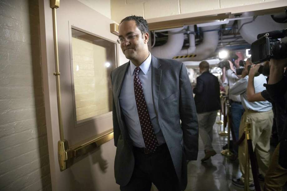 Rep. Will Hurd, R-Texas, whose congressional district runs along the majority of Texas's border with Mexico, arrives for a closed-door GOP meeting in the basement of the Capitol as the Republican leadership tries to reach a policy agreement between conservatives and moderates on immigration, in Washington, Thursday, June 7, 2018. . (AP Photo/J. Scott Applewhite) Photo: J. Scott Applewhite, STF / Associated Press / Copyright 2018 The Associated Press. All rights reserved.